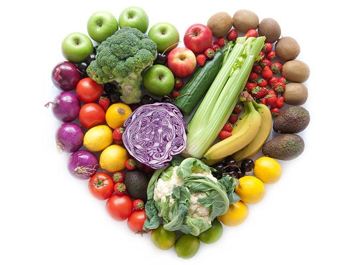 numerous vegetables in the shape of a heart